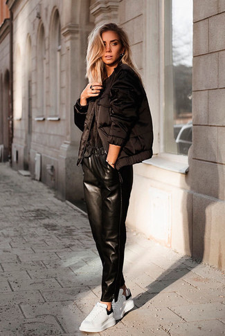 How to wear: white leather low top sneakers, black leather pajama pants, black crew-neck t-shirt, black puffer jacket