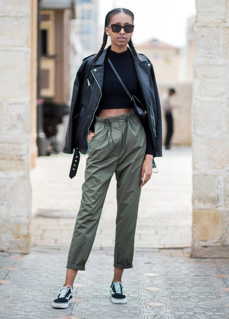 How to wear: black canvas low top sneakers, olive pajama pants, black cropped sweater, black leather biker jacket