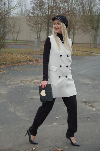 How to wear: black leather pumps, black pajama pants, black turtleneck, white sleeveless coat