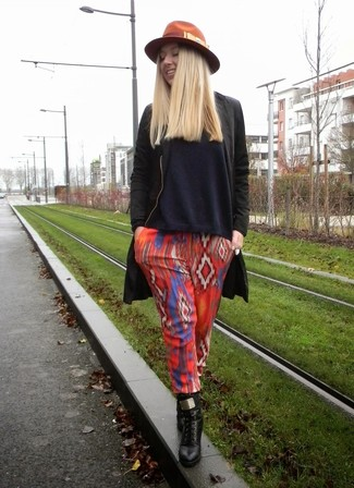 How to wear: black leather lace-up ankle boots, red geometric pajama pants, navy v-neck sweater, black coat