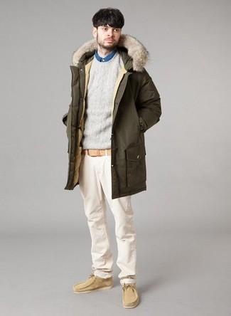 How to wear: olive parka, grey crew-neck sweater, blue denim shirt, beige chinos