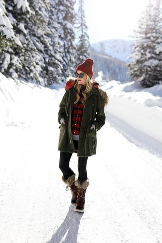 How to wear: olive parka, grey crew-neck sweater, red and black gingham dress shirt, black leggings