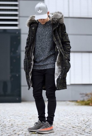 How to wear: olive camouflage parka, charcoal crew-neck sweater, black skinny jeans, grey athletic shoes