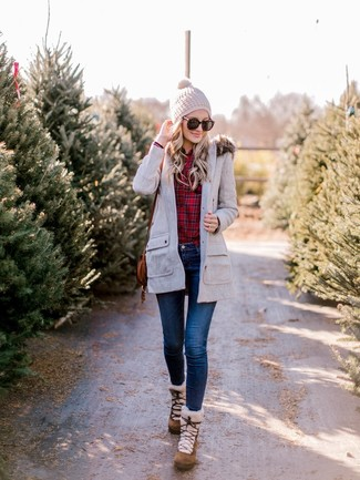 How to wear: grey parka, red plaid dress shirt, navy skinny jeans, brown suede snow boots