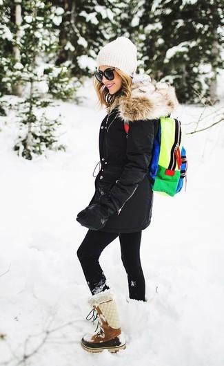 How to wear: black parka, grey hoodie, black leggings, brown suede snow boots
