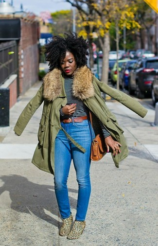 How to wear: olive parka, black and white horizontal striped long sleeve t-shirt, blue skinny jeans, tan leopard suede ankle boots