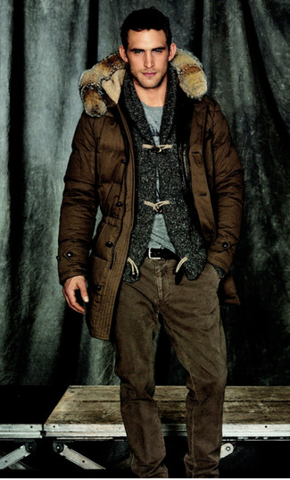 How to wear: dark brown parka, charcoal shawl cardigan, grey crew-neck t-shirt, brown jeans