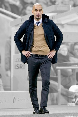 How to wear: navy parka, charcoal vertical striped suit, tan v-neck sweater, white dress shirt