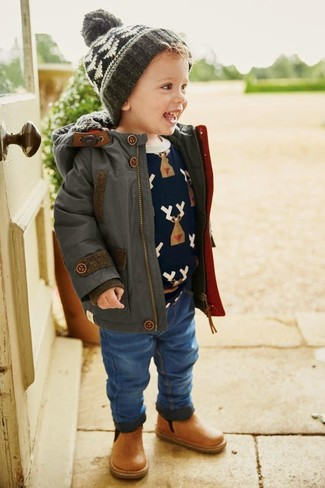 How to wear: charcoal parka, navy print sweater, blue jeans, tan leather boots