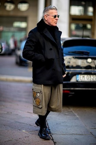 Nick Wooster wearing Black Pea Coat, Beige Wool Chinos, Black Leather Derby Shoes, Black Knit Scarf