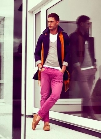 How to wear: violet pea coat, grey crew-neck sweater, hot pink chinos, tan suede driving shoes