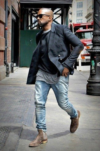 Kanye West wearing Black Pea Coat, Black Crew-neck Sweater, Grey Crew-neck T-shirt, Light Blue Jeans