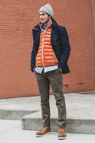 How to wear: navy pea coat, orange gilet, navy and white gingham long sleeve shirt, olive chinos
