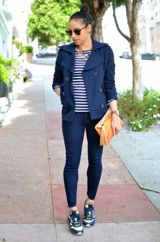 How to wear: navy pea coat, navy and white horizontal striped long sleeve t-shirt, navy skinny jeans, navy athletic shoes