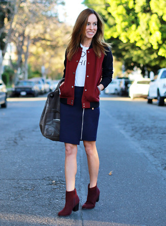 How to wear: burgundy suede ankle boots, navy pencil skirt, white and black print crew-neck t-shirt, burgundy varsity jacket