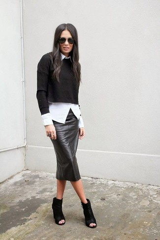 How to wear: black cutout leather ankle boots, black leather pencil skirt, white dress shirt, black cropped sweater
