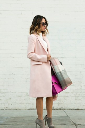 How to Wear Grey Suede Ankle Boots: Pair a pink coat with a dark brown pencil skirt for glamour with a twist. Look at how well this ensemble goes with grey suede ankle boots.