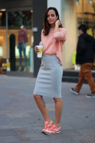 How to wear: pink athletic shoes, grey pencil skirt, pink long sleeve t-shirt