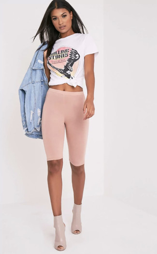 How to wear: beige cutout leather ankle boots, pink bike shorts, white and pink print crew-neck t-shirt, light blue ripped denim jacket