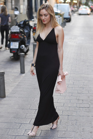 How to wear: black leather bracelet, pink leather clutch, pink leather heeled sandals, black maxi dress