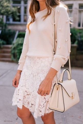 A pale pink embellished crew-neck sweater and a white lace mini skirt are great staples that will integrate perfectly within your current looks.