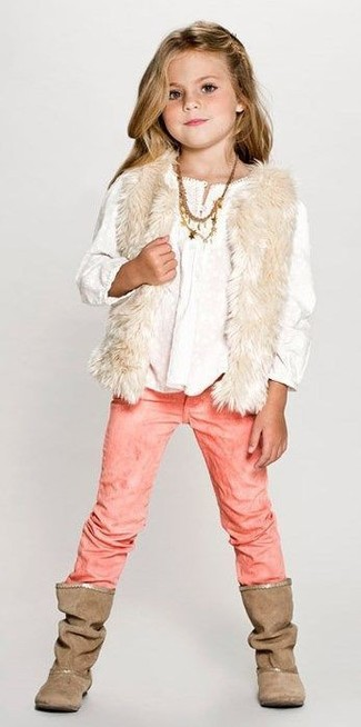 How to Wear Brown Boots For Girls: Dressing in a beige fur vest and pink jeans is a savvy fashion choice for your child. As far as footwear is concerned, suggest that your little girl opt for a pair of brown boots.