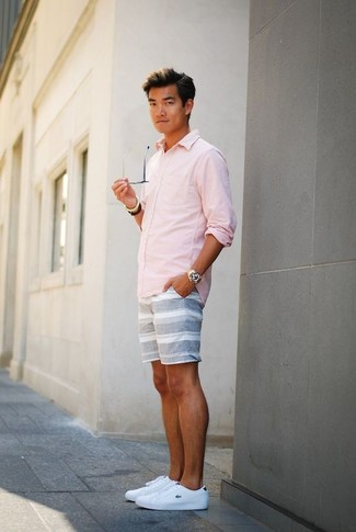 How to wear: pink long sleeve shirt, grey horizontal striped shorts, white leather low top sneakers, gold watch