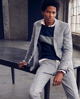 Men's Looks & Outfits: What To Wear In 2020: A grey check suit and a navy and white crew-neck sweater are a combination that every dapper gent should have in his wardrobe.