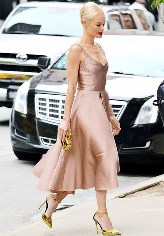 How to wear: pink satin fit and flare dress, gold leather pumps, gold clutch