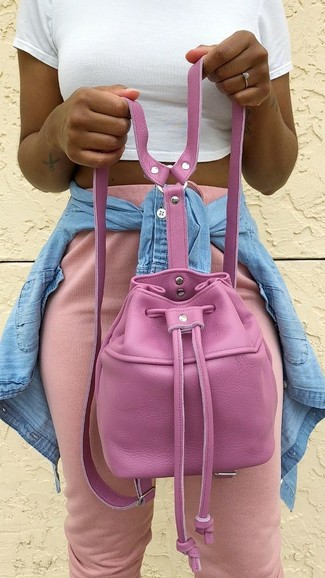 How to wear: hot pink leather bucket bag, pink sweatpants, white cropped top, light blue denim shirt