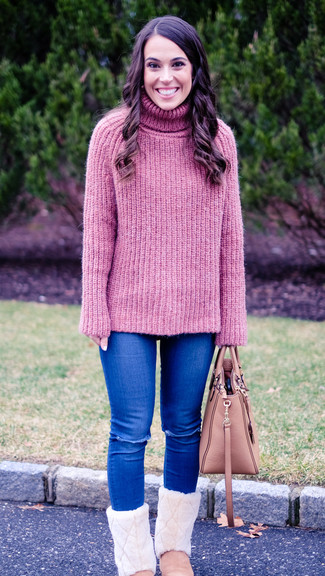 How to wear: pink leather tote bag, pink uggs, blue ripped skinny jeans, pink knit turtleneck
