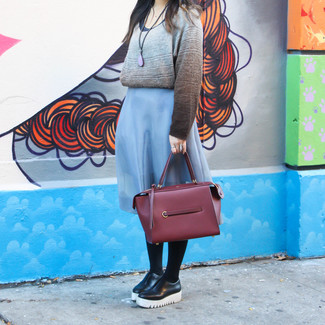 How to wear: burgundy leather tote bag, black leather platform loafers, light blue midi skirt, grey horizontal striped crew-neck sweater
