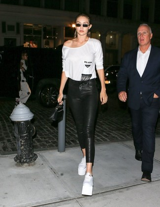 How to wear: black leather clutch, white leather platform loafers, black leather skinny jeans, white long sleeve t-shirt