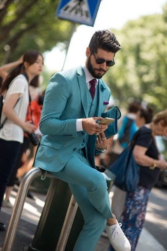 How to wear: dark purple tie, white plimsolls, white dress shirt, teal three piece suit