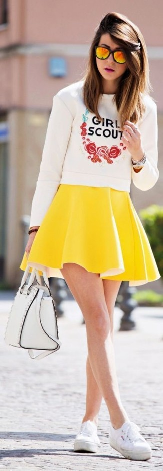 How to wear: white leather satchel bag, white plimsolls, yellow skater skirt, white print crew-neck sweater
