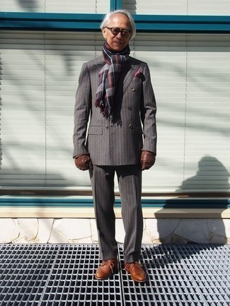 How to Wear Brown Leather Gloves For Men: We give a big thumbs up to this relaxed casual pairing of a grey vertical striped suit and brown leather gloves! For extra style points, introduce tobacco leather derby shoes to the equation.