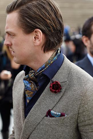 How to wear: burgundy lapel pin, burgundy print pocket square, navy polka dot long sleeve shirt, grey wool blazer