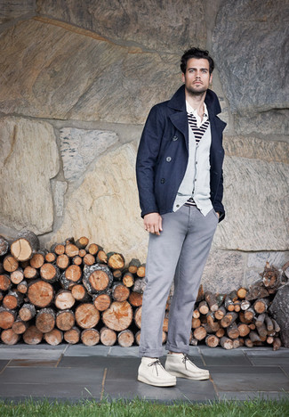 How to wear: grey chinos, white and black horizontal striped polo, grey cardigan, navy pea coat