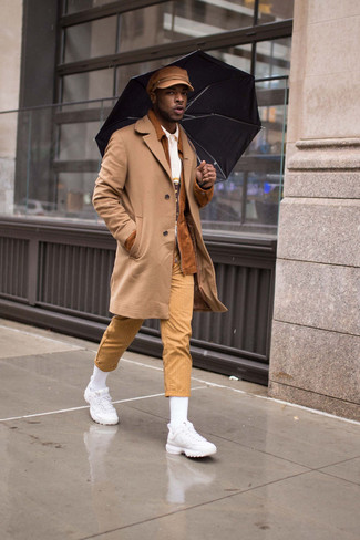 How to Wear White Athletic Shoes For Men: A camel overcoat and khaki vertical striped chinos are the perfect way to inject extra refinement into your day-to-day off-duty rotation. White athletic shoes will contrast beautifully against the rest of the look.