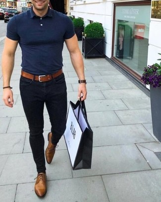 How to wear: navy polo, black skinny jeans, brown leather oxford shoes, tobacco leather belt