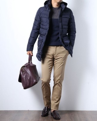 How to wear: navy puffer coat, navy crew-neck sweater, khaki chinos, dark brown leather loafers