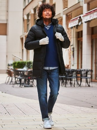 How to wear: black puffer coat, navy v-neck sweater, white and navy gingham long sleeve shirt, navy jeans