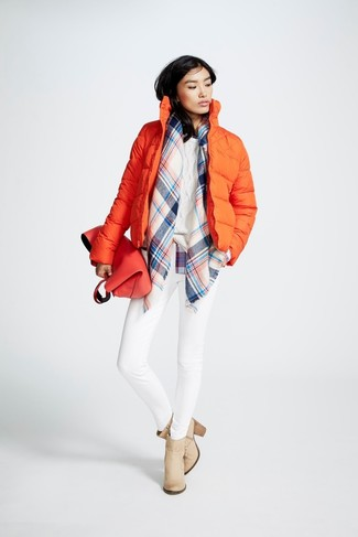 How to wear: orange puffer jacket, white cable sweater, white skinny jeans, beige leather ankle boots