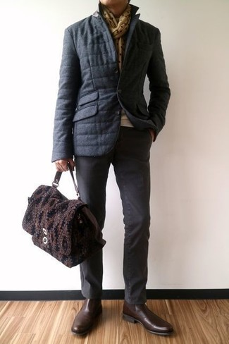 How to wear: charcoal puffer jacket, beige crew-neck sweater, charcoal chinos, dark brown leather chelsea boots