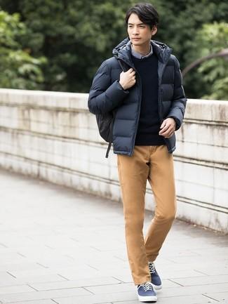 How to wear: navy puffer jacket, navy crew-neck sweater, blue gingham long sleeve shirt, khaki chinos