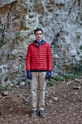 How to wear: red puffer jacket, blue hoodie, beige chinos, black leather work boots