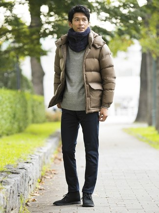 How to wear: tan puffer jacket, grey sweatshirt, navy chinos, black suede desert boots
