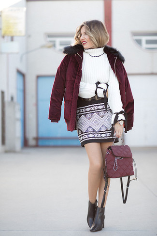 How to wear: burgundy puffer jacket, white knit turtleneck, black geometric mini skirt, black leather ankle boots