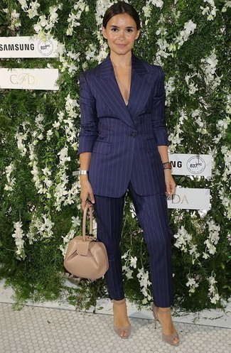 How to Wear Navy Vertical Striped Dress Pants For Women: This is hard proof that a navy vertical striped blazer and navy vertical striped dress pants look amazing together in a relaxed ensemble. Complement this ensemble with a pair of beige suede pumps and you're all done and looking stunning.