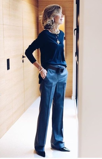 How to wear: black leather belt, black leather pumps, navy dress pants, navy crew-neck sweater